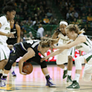 Kansas State's Kindred Wesemann (24) has the ball stripped away as Baylor's Niya Johnson, left, Kristy Wallace, right, and Nina Davis, rear, defend on the play in the first half of an NCAA college basketball game, Saturday, Jan. 24, 2015, in Waco. (AP Photo/Tony Gutierrez)