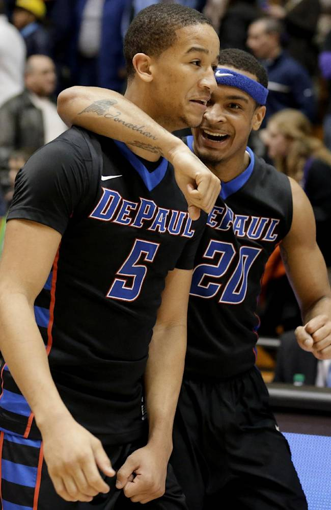 DePaul guard Billy Garrett Jr., left, celebrates with guard Brandon Young after DePaul defeated Northwestern 57-56 in an NCAA college basketball game Friday, Dec. 27, 2013, in Evanston, Ill
