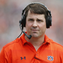 FILE - In this April 18, 2015, file photo, Auburn defensive coordinator Will Muschamp walks around the football field in the first quarter during their spring NCAA college football game in Auburn, Ala. The SEC will have 14 new coordinators this season. In typical SEC style, some have been spare-no-expense hires. Defensive coordinators Will Muschamp of Auburn and John Chavis of Texas A&M are each making at least $5 million over the next three years at their new jobs.(AP Photo/Brynn Anderson, File)