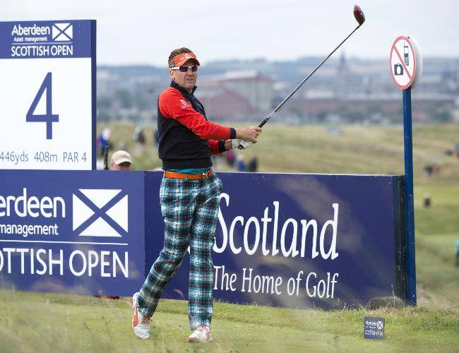 England's Ian Poulter tees off at the 4th during day one of the Scottish Open at Royal Aberdeen golf course, Aberdeen Scotland Thursday July 10, 2014