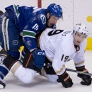 Vancouver Canucks centre Brad Richardson (15) fights for control of the puck with Anaheim Ducks defenceman Stephane Robidas (19) during the first period of NHL action in Vancouver, British Columbia, on Monday, April 7, 2014 The Associated Press