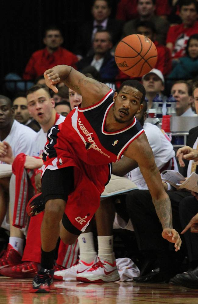 Washington Wizards forward Trevor Ariza chases a loose ball during play against the Houston Rockets in the second half of an NBA basketball game in Houston, Wednesday, Feb. 12, 2014