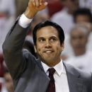 FILE - In this June 17, 2012, file photo, Miami Heat head coach Erik Spoelstra makes a call from the sideline against the Oklahoma City Thunder during the first half at Game 3 of the NBA Finals basketball series in Miami.  It's training camp time. The NBA champion Miami Heat return to practice on Saturday.  (AP Photo/Lynne Sladky)