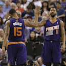 Phoenix Suns forward Marcus Morris, left, congratulates his twin brother, Markieff, after he scored against the Sacramento Kings during the fourth quarter of an NBA basketball game in Sacramento, Calif., Wednesday, April 16, 2014. The Suns won 104-99 The