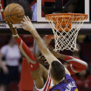 Houston Rockets' Dwight Howard, left, shoots as Phoenix Suns' Miles Plumlee (22) defends during the first quarter of an NBA basketball game Wednesday, Dec. 4, 2013, in Houston The Associated Press