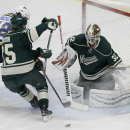Minnesota Wild goalie Niklas Backstrom (32), of Finland, deflects a shot in front of St. Louis Blues center David Backes (42) and Wild defenseman Jonas Brodin, center, during the first period of an NHL hockey game in St. Paul, Minn., Saturday, Nov. 29, 20