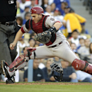 Arizona Diamondbacks catcher Miguel Montero goes after the ball during the fifth inning of a baseball game against the Los Angeles Dodgers, Saturday, April 19, 2014, in Los Angeles The Associated Press