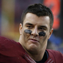 Washington Redskins outside linebacker Ryan Kerrigan (91) looks down the bench during the second half of an NFL football game against the Dallas Cowboys in Landover, Md., Sunday, Dec. 28, 2014. The Cowboys won 44-17. (AP Photo/Alex Brandon)