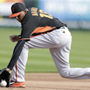 San Francisco Giants third baseman Joaquin Arias stops a ground ball during a spring training baseball practice Sunday, Feb. 23, 2014, in Scottsdale, Ariz The Associated Press