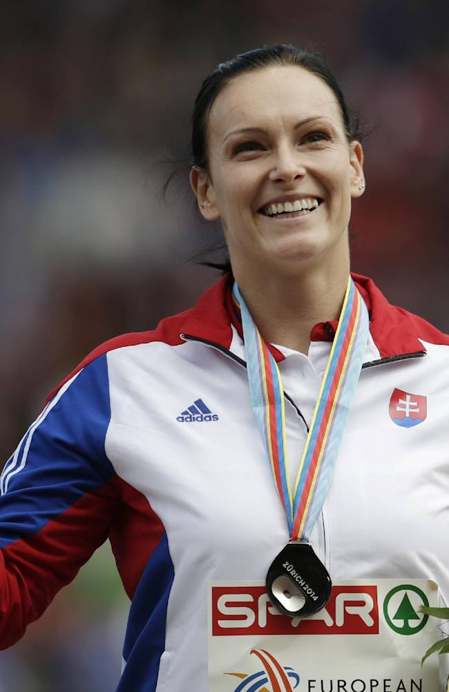 Slovakia's Martina Hrasnova celebrates on the podium after winning silver in the hammer throw final during the European Athletics Championships in Zurich, Switzerland, Saturday, Aug. 16, 2014