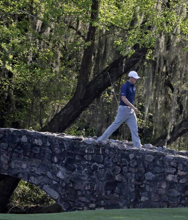 Jordan Spieth walks across the Hogan Bridge during the third round of the Masters golf tournament Saturday, April 12, 2014, in Augusta, Ga