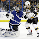 Tampa Bay Lightning goalie Ben Bishop (30) makes a save in front of Boston Bruins center Carl Soderberg (34), of Sweden, during the first period of an NHL hockey game on Saturday, March 8, 2014, in Tampa, Fla The Associated Press