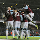 West Ham United s players celebrate with their teammate Mohamed Diame, second right, after he scored against Fulham during their English Premier League soccer match in London, Saturday, Nov. 30, 2013