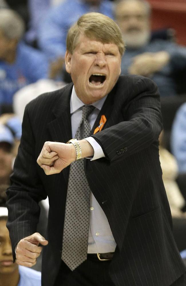 North Carolina associate head coach Andrew Calder argues a call during the first half of an NCAA college basketball game against Wake Forest in Winston-Salem, N.C., Thursday, Jan. 23, 2014
