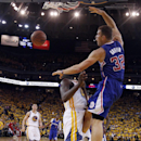 Los Angeles Clippers' Blake Griffin (32) dunks over Golden State Warriors' Draymond Green, bottom, during the second half in Game 3 of an opening-round NBA basketball playoff series on Thursday, April 24, 2014, in Oakland, Calif. Los Angeles won 98-96 The