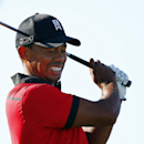 Tiger Woods reacts to his tee shot on the 17th hole during the final round of The Barclays golf tournament on Sunday, Aug. 25, 2013, in Jersey City, N.J. Woods finished in a four-way tie for second place. (AP Photo/Rich Schultz)