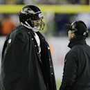Baltimore Ravens head coach John Harbaugh talks to Baltimore Ravens quarterback Joe Flacco, left, in the second half of an NFL divisional playoff football game Saturday, Jan. 10, 2015, in Foxborough, Mass The Associated Press