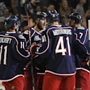 Columbus Blue Jackets' Matt Calvert (11) celebrates with teammates after scoring his second goal against the Carolina Hurricanes, in the second period of a preseason NHL hockey game, Wednesday, Oct. 1, 2014 in Columbus, Ohio. Columbus won 6-3 The Associat