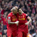 Liverpool's Martin Skrtel, left, celebrates with teammate Luis Suarez after their team beats Manchester City 3-2 in their English Premier League soccer match at Anfield Stadium, Liverpool, England, Sunday April 13, 2014