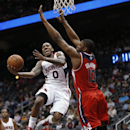 Atlanta Hawks guard Jeff Teague (0) goes up for a shot as Washington Wizards center Kevin Seraphin (13) defends during the first half of an NBA basketball basketball game Wednesday, Feb. 19, 2014, in Atlanta The Associated Press