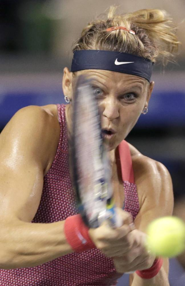 Lucie Safarova of the Czech Republic returns the ball against Samantha Stosur of Australia during their third round match of the Pan Pacific Open tennis tournament in Tokyo, Wednesday, Sept. 25, 2013. Safarova won 6-4, 6-4