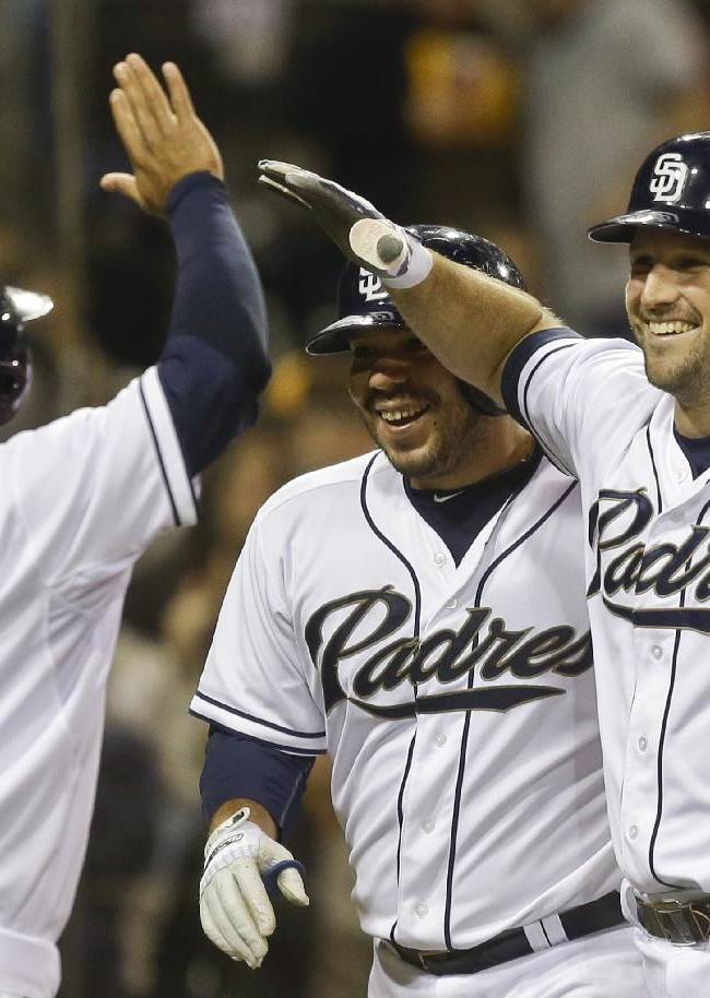 San Diego Padres' Chris Robinson celebrates with Alexi Amarista and Rene Rivera after belting a home run for the first hit of his career in the eighth inning of a baseball game against the Arizona Diamondbacks Wednesday, Sept. 25, 2013, in San Diego