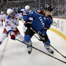 Colorado Avalanche center Brad Malone (42) and New York Rangers defenseman Marc Staal (18) chase the puck into the corner during the first period of an NHL hockey game on Thursday, April 3, 2014, in Denver The Associated Press