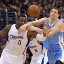 Los Angeles Clippers forward Glen Davis, left, and Denver Nuggets center Timofey Mozgov, of Russia, compete for a loose ball during the first half of an NBA basketball game, Tuesday, April 15, 2014, in Los Angeles The Associated Press