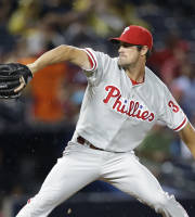 Philadelphia Phillies starting pitcher Cole Hamels works in the first inning of a baseball game against the Atlanta Braves in Atlanta, Monday, Aug. 12, 2013. (AP Photo/John Bazemore)