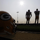 Green Bay Packers' Brett Goode and Tim Masthay watch during NFL football training camp Monday, July 28, 2014, in Green Bay, Wis The Associated Press