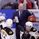 Boston Bruins head coach Claude Julien directs his team during the third period of Game 3 of a first-round NHL hockey playoff series against the Detroit Red Wings in Detroit, Tuesday, April 22, 2014 The Associated Press