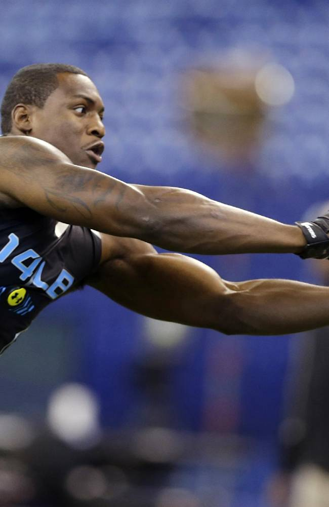 Florida State linebacker Christian Jones makes a catch as he runs a drill at the NFL football scouting combine in Indianapolis, Monday, Feb. 24, 2014