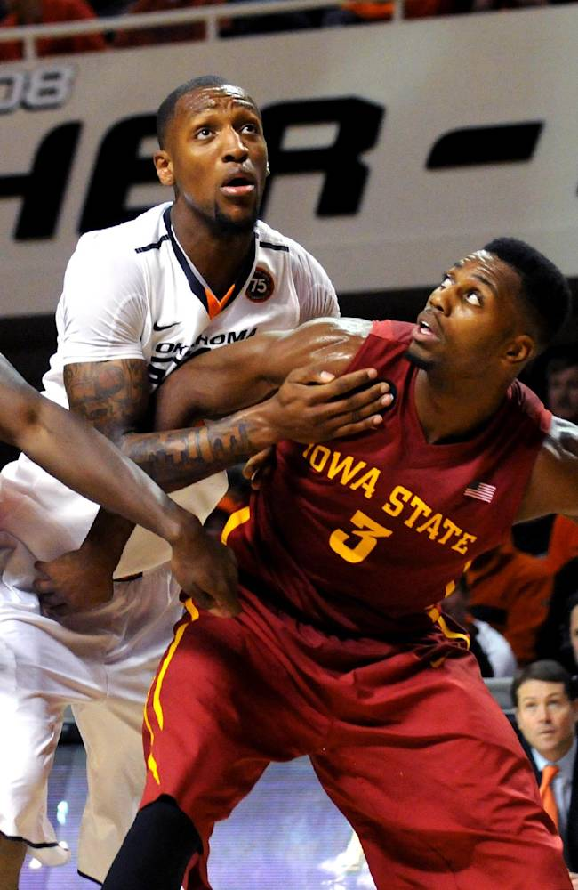 Iowa State's Dustin Hogue, left, and Melvin Ejim, right, block out Oklahoma State's Kamari Murphy, center, during an NCAA college basketball game in Stillwater, Okla., Monday, Feb. 3, 2014. Hogue scored 13 points in the 98-97 triple overtime win over Oklahoma State