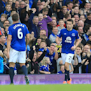 Everton's Seamus Coleman, right, celebrates scoring his side's third goal of the game during their English Premier League soccer match against Aston Villa at Goodison Park, Liverpool, England, Saturday, Oct. 18, 2014