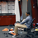 Phoenix Suns' Channing Frye laces up his shoe in the locker room after an NBA basketball game against the Memphis Grizzlies, Monday, April 14, 2014, in Phoenix. The Grizzlies won 97-91 eliminating the Suns from the playoffs The Associated Press