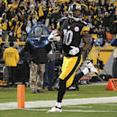 Pittsburgh Steelers wide receiver Martavis Bryant heads to the end zone to score a touchdown after making a catch during the second quarter of an NFL football game against the Cincinnati Bengals, Sunday, Dec. 28, 2014, in Pittsburgh. (AP Photo/Don Wright)