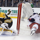 Columbus Blue Jackets' David Savard (58) crashes into the net beside Boston Bruins' Tuukka Rask (40), of Finland, during the third period of an NHL hockey game in Boston, Saturday, Jan. 17, 2015. The Blue Jackets won 3-1 The Associated Press