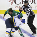 CORRECTS SCORE TO 4-3-Dallas Stars Curtis McKenzie (11) fights with St. Louis Blues center Steve Ott (9) as linesman Pierre Racicot (65) tries to break them up during the third period of an NHL pre-season hockey game, Monday, Sept. 22, 2014, in Dallas. The Stars won 4-3. (AP Photo/LM Otero)