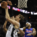San Antonio Spurs forward Tiago Splitter, left, of Brazil, chases the rebound against Detroit Pistons forward Josh Smith, right, during the first half of an NBA basketball game on Wednesday, Feb. 26, 2014, in San Antonio The Associated Press