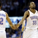 Oklahoma City Thunder forward Kevin Durant (35) celebrates his 3-point shot with Thabo Sefolosha (2) during the first half of  Game 2 in their Western Conference semifinal NBA basketball playoff series against the Memphis Grizzlies on Tuesday, May 7, 2013, in Oklahoma City. (AP Photo/Tony Gutierrez)
