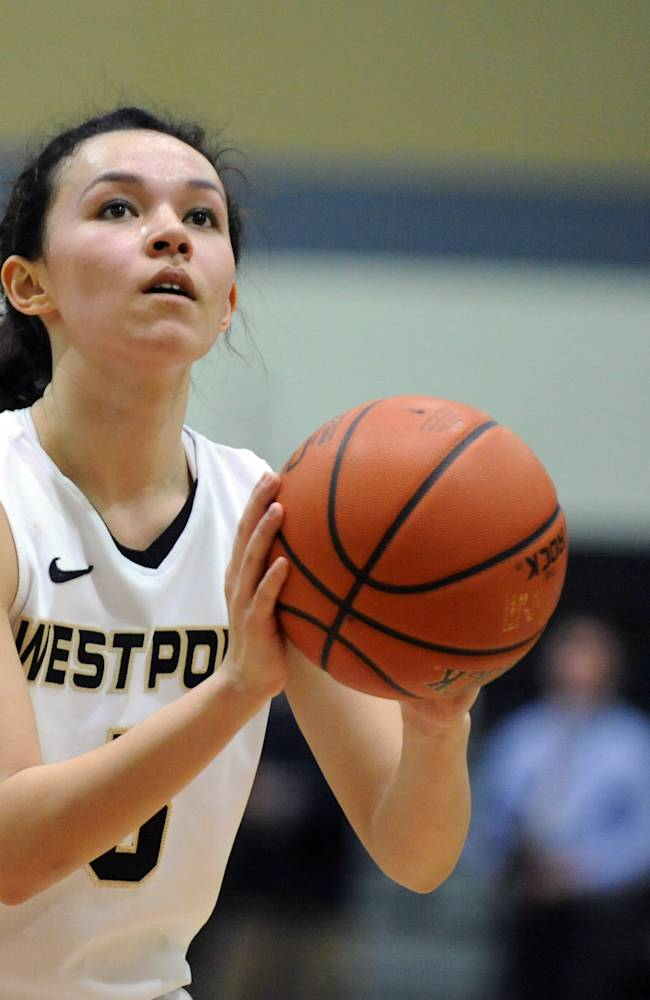 The tournament's most valuable player, Army's Kelsey Minato, takes a foul shot during the second half of an NCAA college basketball game in the Patriot League Championship against Holy Cross at Christi Arena, Saturday, March 15, 2014, at West Point, N.Y. Army won 68-58