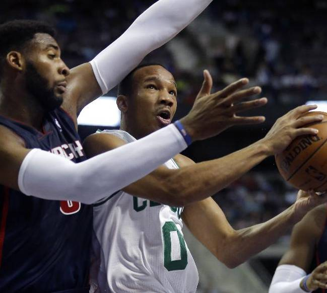 Boston Celtics guard Avery Bradley (0) goes to the basket against Detroit Pistons center Andre Drummond (0) during the first half of an NBA basketball game Sunday, Nov. 3, 2013, in Auburn Hills, Mich