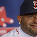 Newly acquired Boston Red Sox free agent third baseman Pablo Sandoval smiles as he responds to a reporter's question after being introduced to the media at Fenway Park Tuesday, Nov. 25, 2014, in Boston. (AP Photo/Stephan Savoia)
