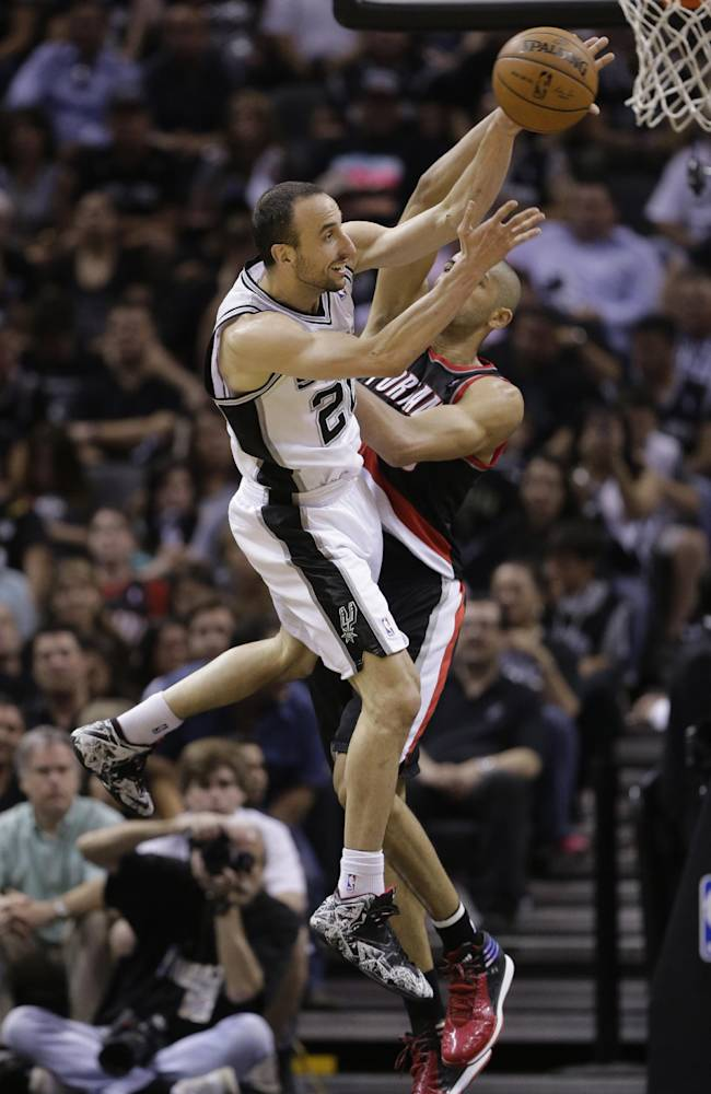 San Antonio Spurs' Manu Ginobili (20), of Argentina, is defended by Portland Trail Blazers' Nicolas Batum, right, during the second half of Game 2 of a Western Conference semifinal NBA basketball playoff series, Thursday, May 8, 2014, in San Antonio. San Antonio won 114-97