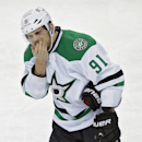 Dallas Stars center Tyler Seguin (91) covers his mouth after being hit with a high stick from Tampa Bay Lightning left wing Ryan Malone during the second period of an NHL hockey game on Saturday, April 5, 2014, in Tampa, Fla. Malone was penalized four min