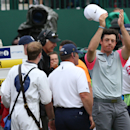 Rory McIlroy of Northern Ireland waves to the crowd as he celebrates winning the British Open Golf championship at the Royal Liverpool golf club, Hoylake, England, Sunday July 20, 2014. (AP Photo/Scott Heppell)
