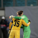 Manchester City's goalkeeper Joe Hart, right, hugs CSKA's goalkeeper Igor Akinfeev after the Champions League Group E soccer match between CSKA Moscow and Manchester City at Arena Khimki stadium in Moscow, Russia, Tuesday Oct. 21, 2014