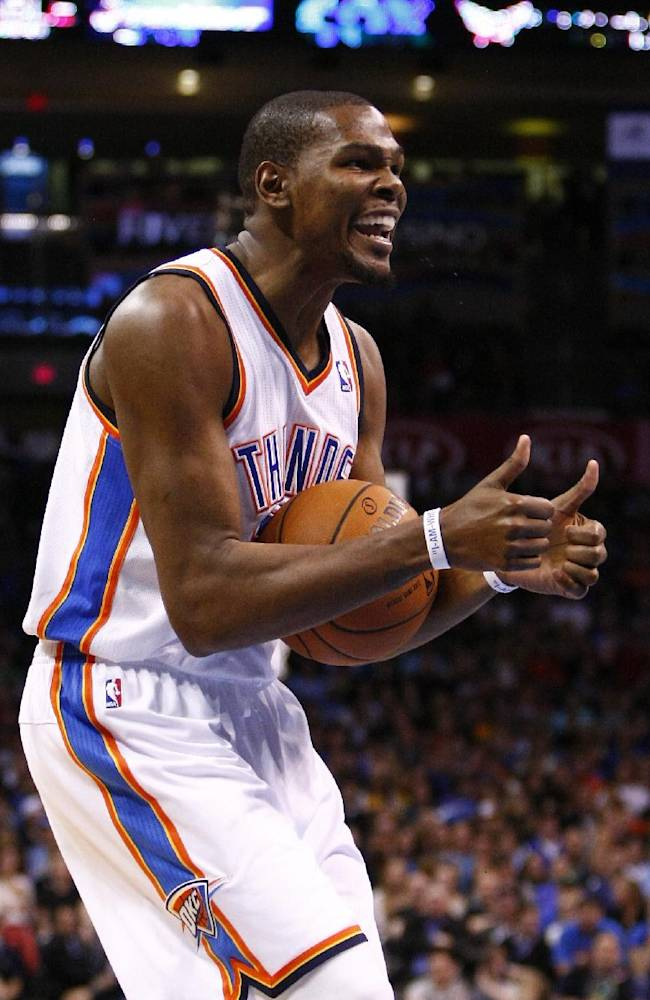 Oklahoma City Thunder forward Kevin Durant (35) reacts to an officials' call during the first quarter of an NBA basketball game against the Los Angeles Lakers in Oklahoma City, Thursday, March 13, 2014