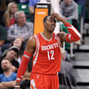 Houston Rockets' Dwight Howard looks up as he walks up court in the fourth quarter of an NBA basketball game against the Utah Jazz, Monday, Dec. 2, 2013, in Salt Lake City. The Jazz won 109-103 The Associated Press