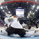 Team Foligno's Phil Kessel (81) of the Toronto Maple Leafs, left, goes top shelf for a goal on Team Toews goalie Jaroslav Halak of the New York Islanders during the third period of the NHL All-Star hockey game in Columbus, Ohio, Sunday, Jan. 25, 2015. Tea